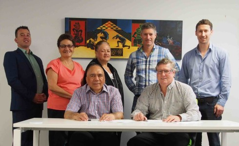 Maungaharuru-Tangitū Trust and Taylor Whānau partnership. Pictured (left to right): Shayne Walker, Charmaine Butler, Cathy Spooner, Stewart Taylor, Logan Taylor, (seated) Tom Manaena, Trevor Taylor.